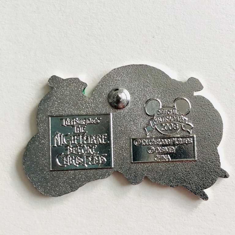 This is a Nightmare Before Christmas pin which shows the franchise stamp as well as the older Disney pin trading stamp