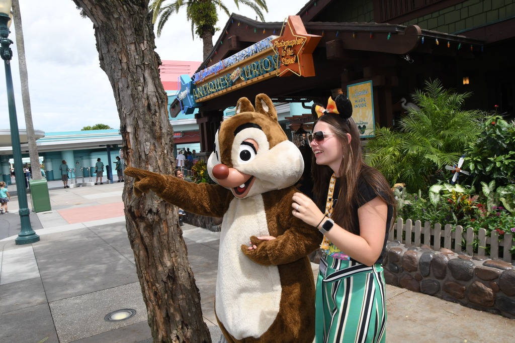 Clair being shown the location of the nearest Chip and Dale pin store!