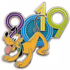 Pluto beside 2019 pin