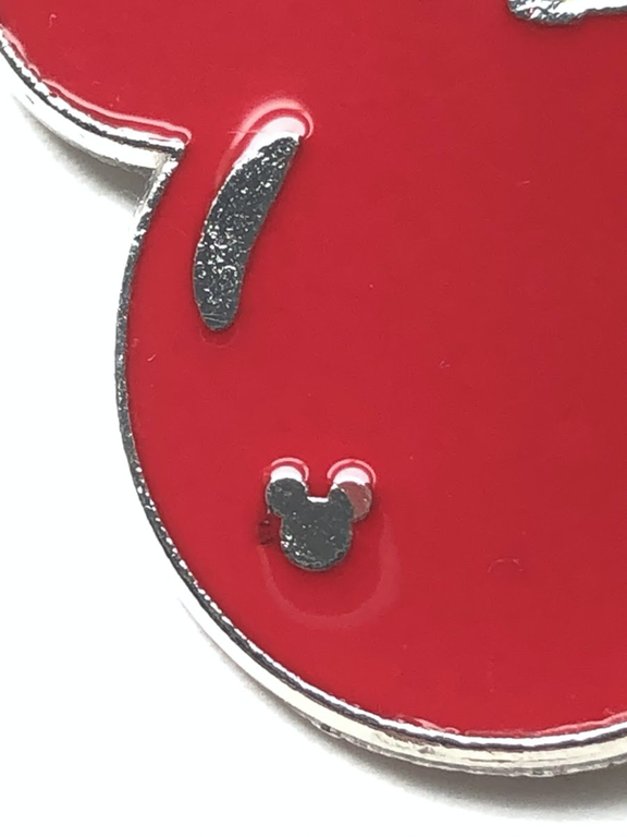 In this example, we see paint over Mickey's ears