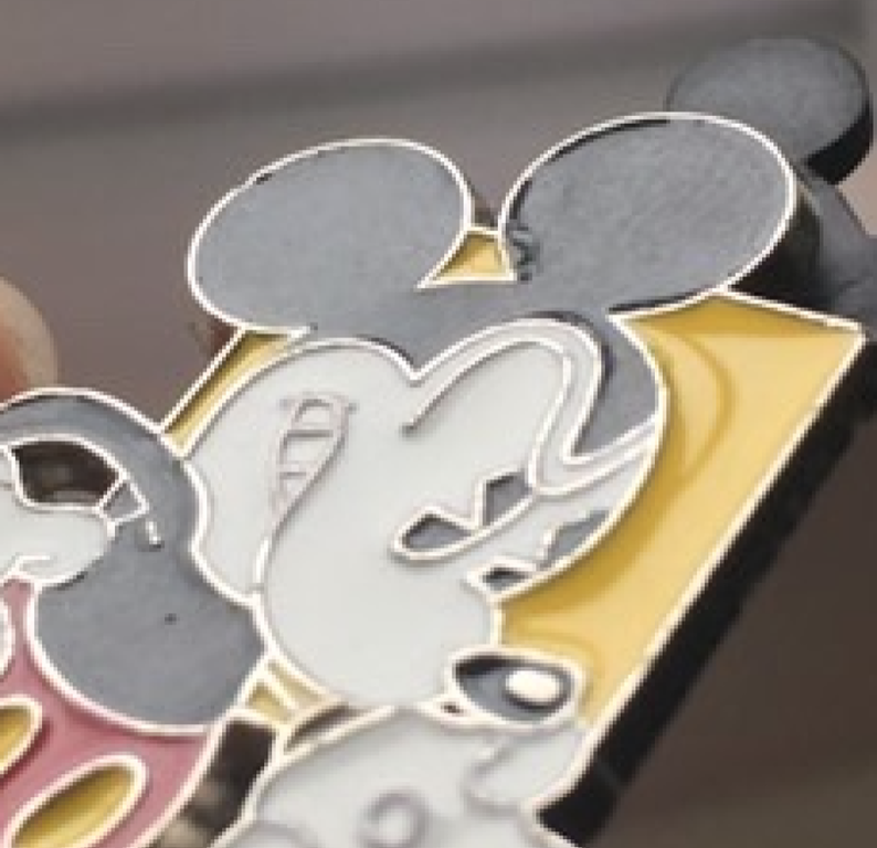 Here you can clearly see brush strokes on Mickey's ear