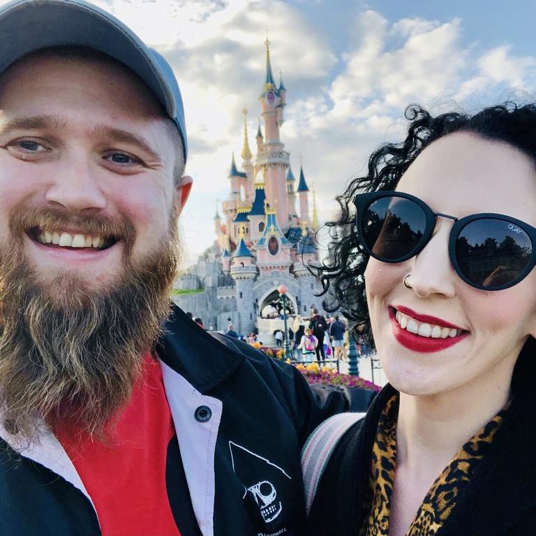 Toby and Elaine standing in front of Sleeping Beauty castle in Disneyland Paris