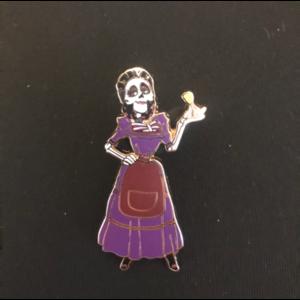 Mama Imelda holding leaf pin