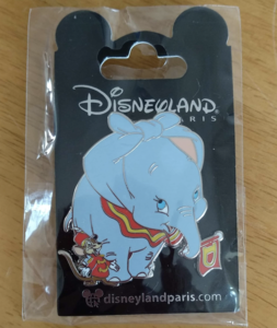 Dumbo and Timothy mouse with a flag pin