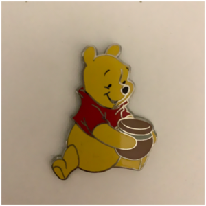 Winnie the Pooh with pot of honey pin