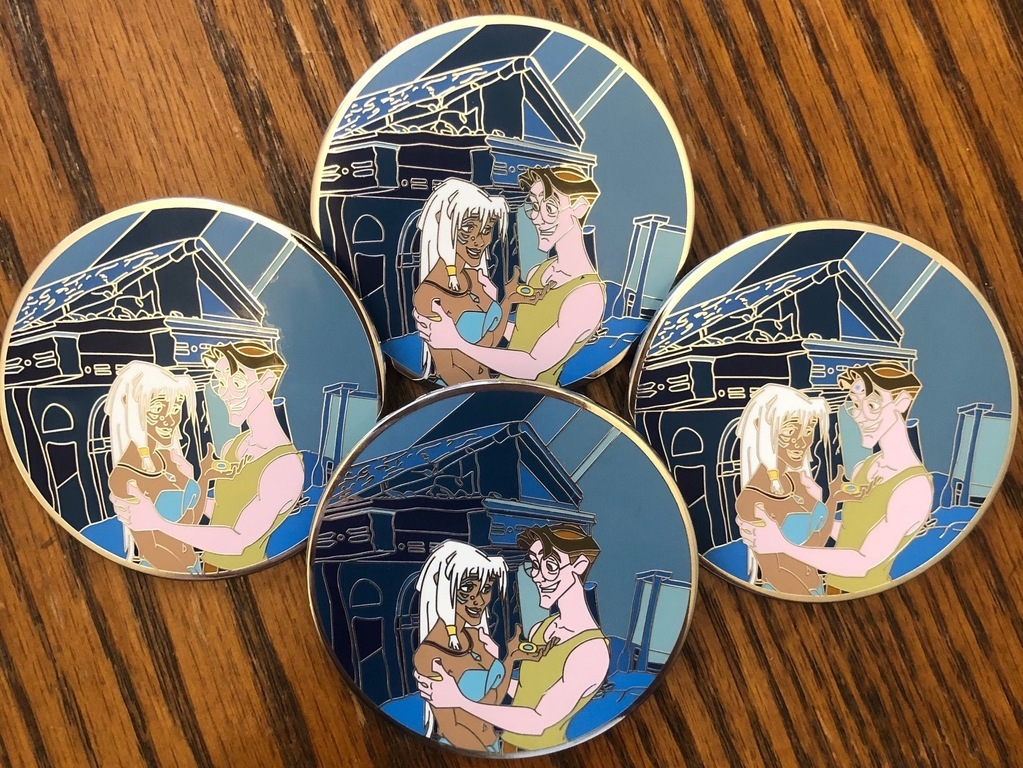4 Atlantis pins of varying quality