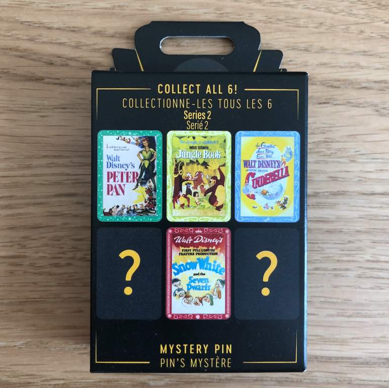 An example of a mystery pin box, showing two blank spaces were other pins designs will be